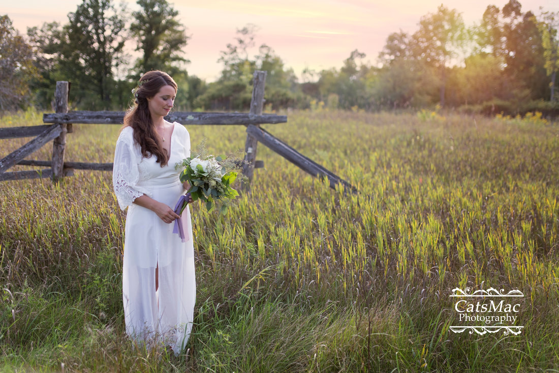 bride in field sunset September