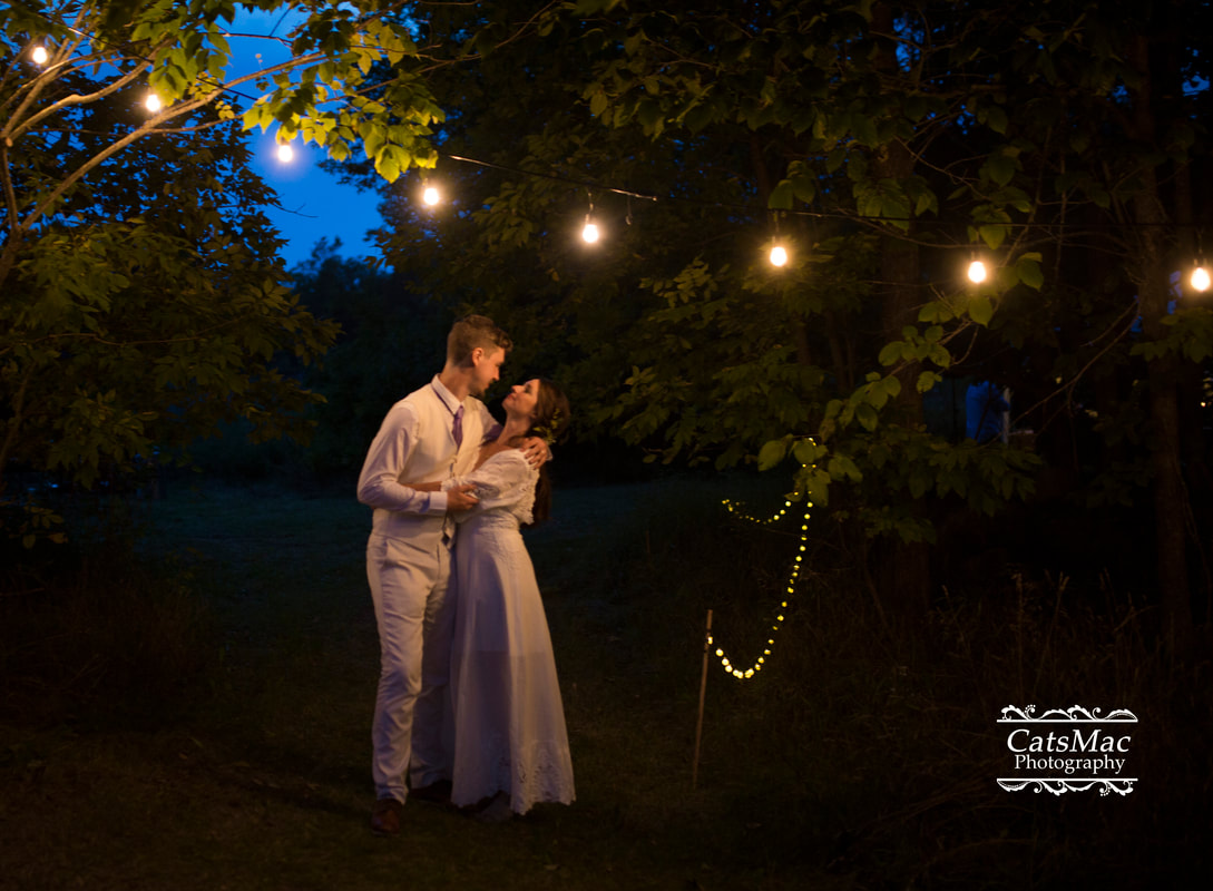 Bride groom night time edison lights