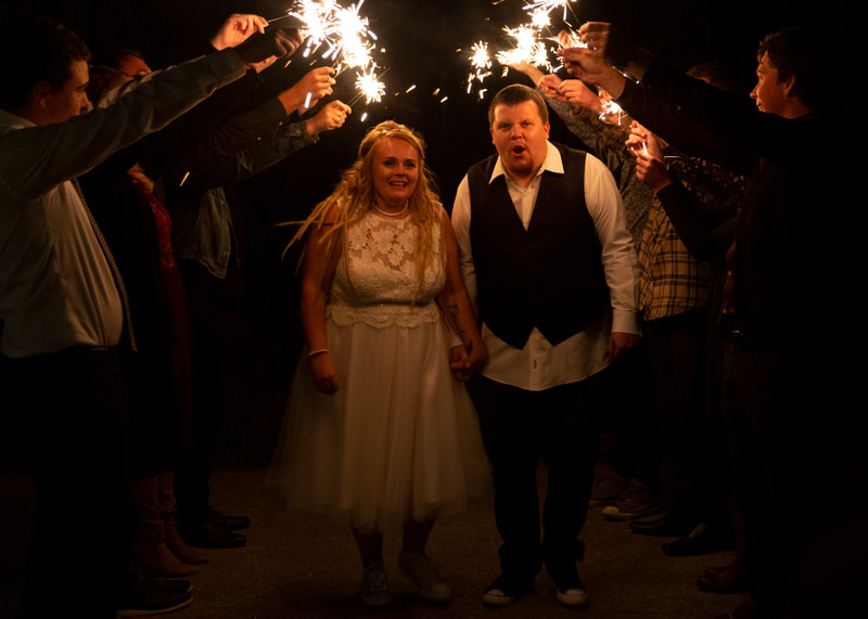 Wedding bride groom sparklers reception